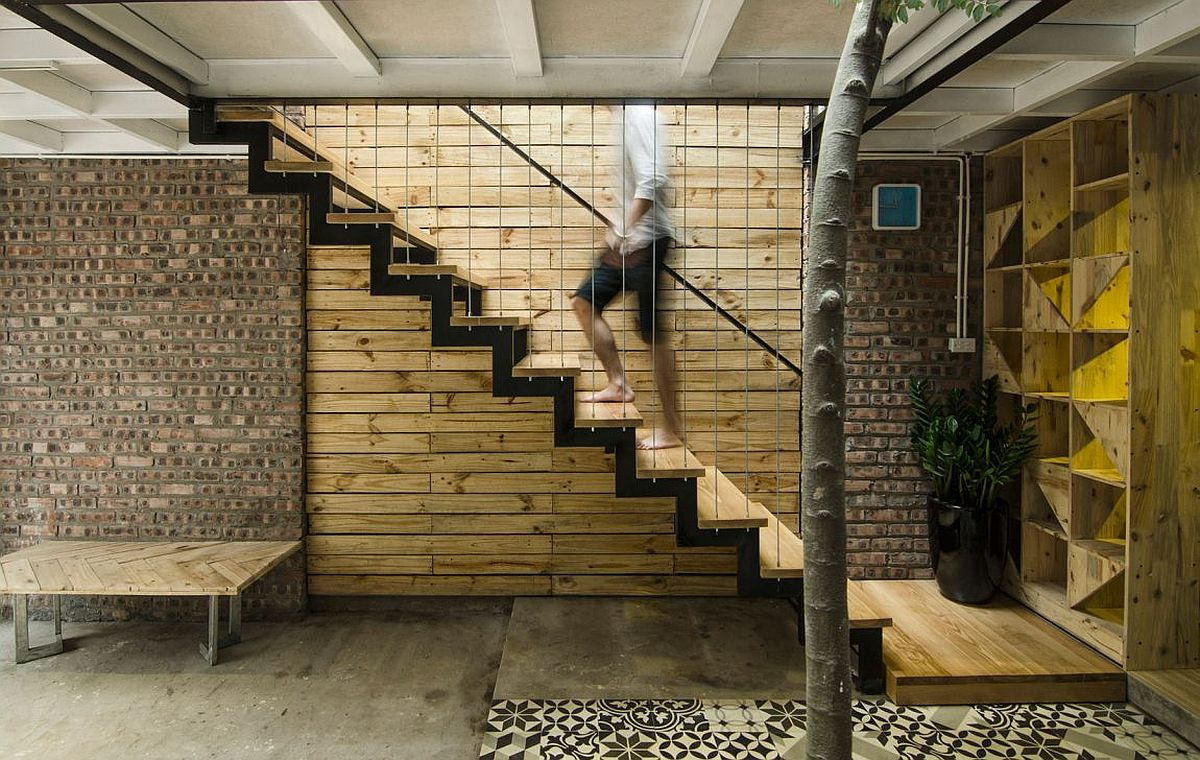 Staircase leading to the top level of the A's House in Vietnam