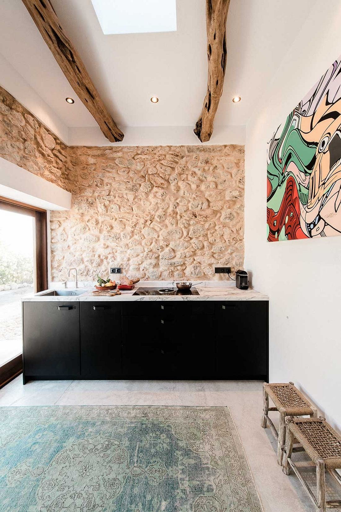 Steel designer kitchen with marble top from Eginstill inside the Ibiza home