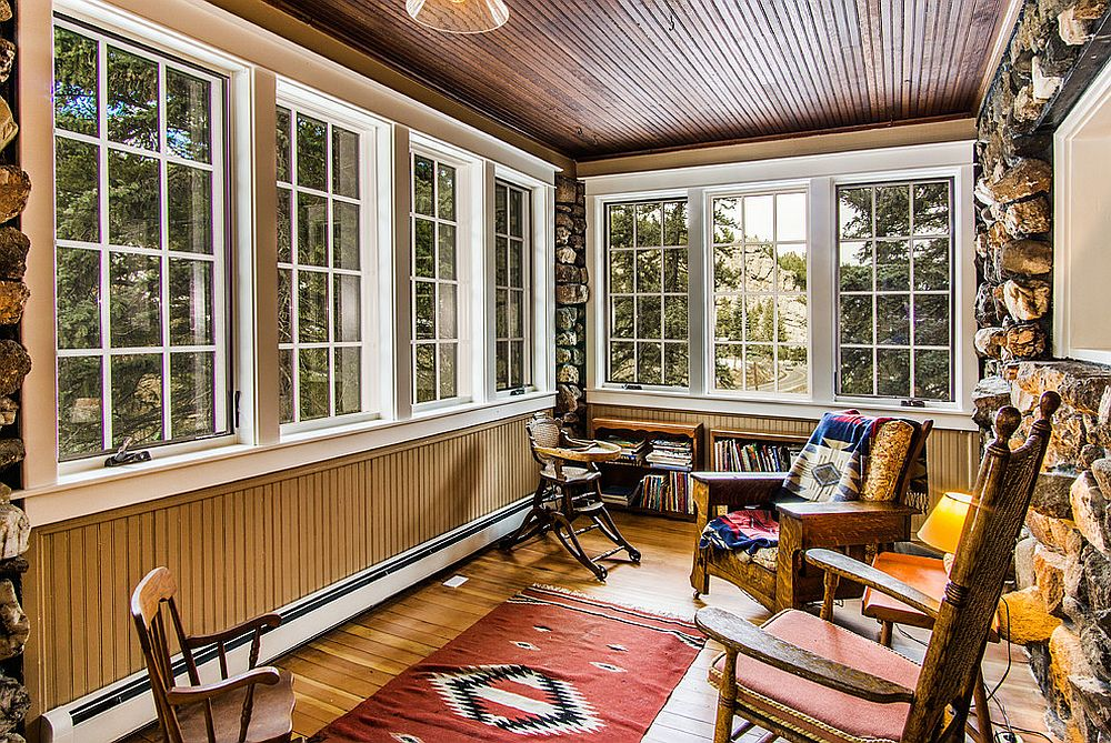 Stone and beadboard walls bring uniqueness to the dashing sunroom Timeless Allure: 30 Cozy and Creative Rustic Sunrooms