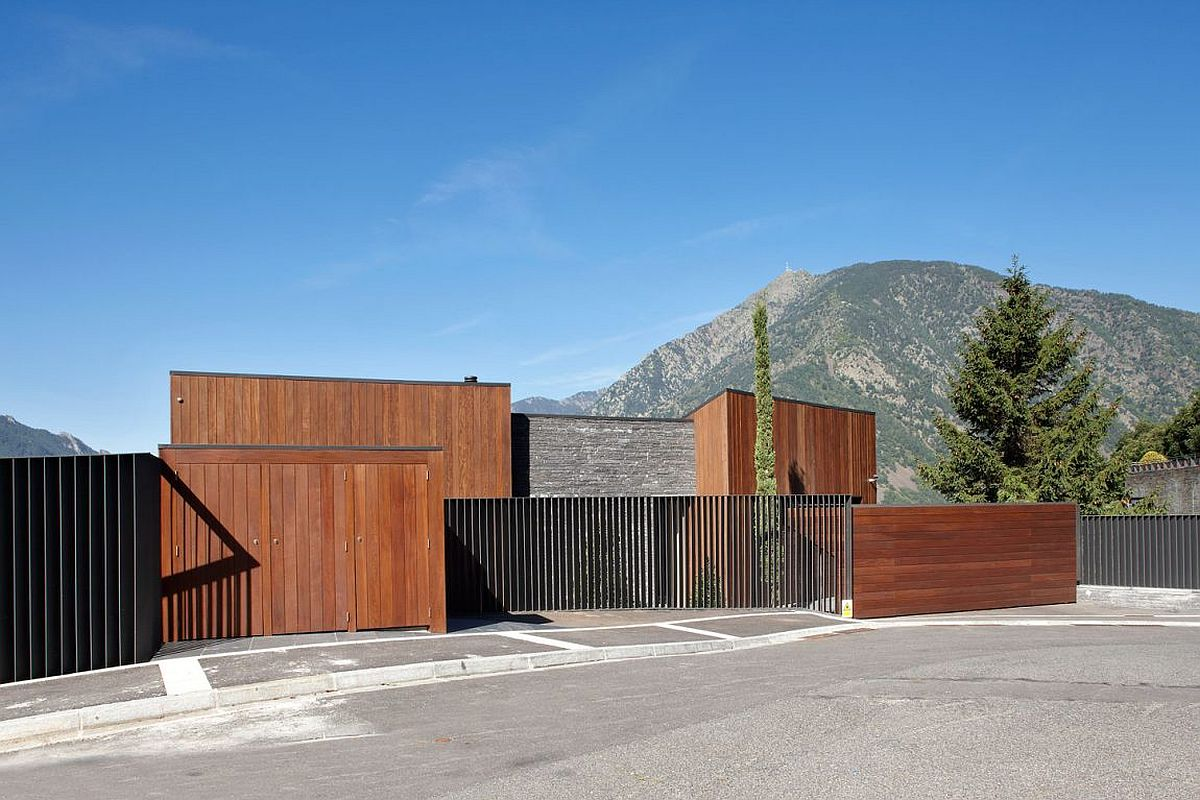 Street facade of the private residence in Andorra clad in wood and stone