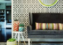 Striking entry design with trellis pattern wallpaper and gorgeous loveseat