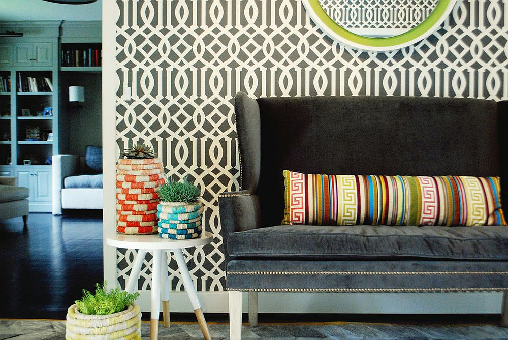 Striking entry design with trellis pattern wallpaper and gorgeous loveseat [Design: Rethink Design Studio]