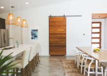Striking-sliding-barn-door-hides-the-pantry-in-this-kitchen-and-dining-space-217x155