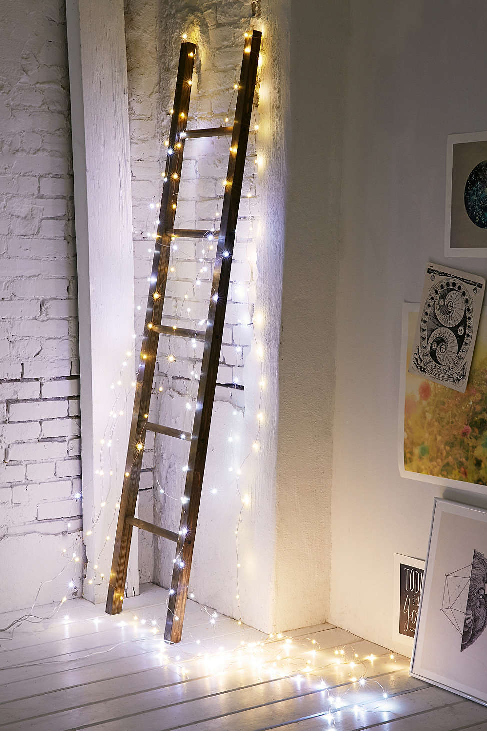 String lights illuminate a corner ladder