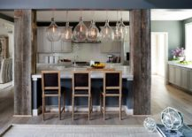 Structural-beams-covered-with-reclaimed-wood-in-the-kitchen-217x155