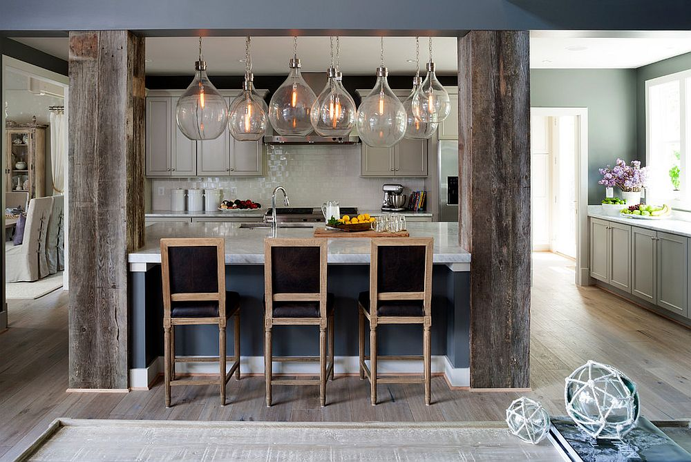 Structural beams covered with reclaimed wood in the kitchen