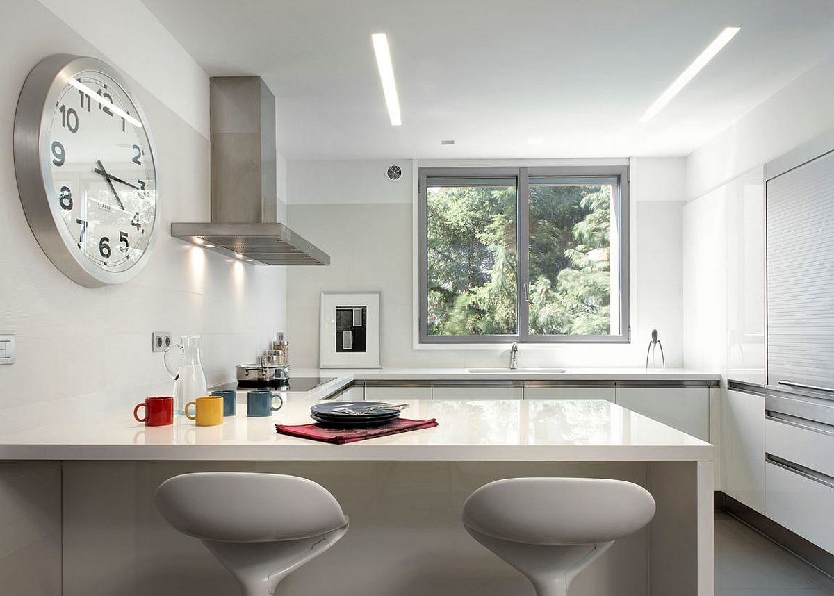Stylish and space-savvy contemporary kitchen in white with breakfast zone