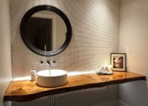 Stylish contemporary powder room with live edge vanity and penny tiled walls