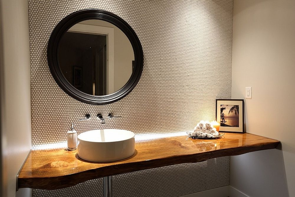 Stylish contemporary powder room with live edge vanity and penny tiled walls [Design: Blackfish Homes]