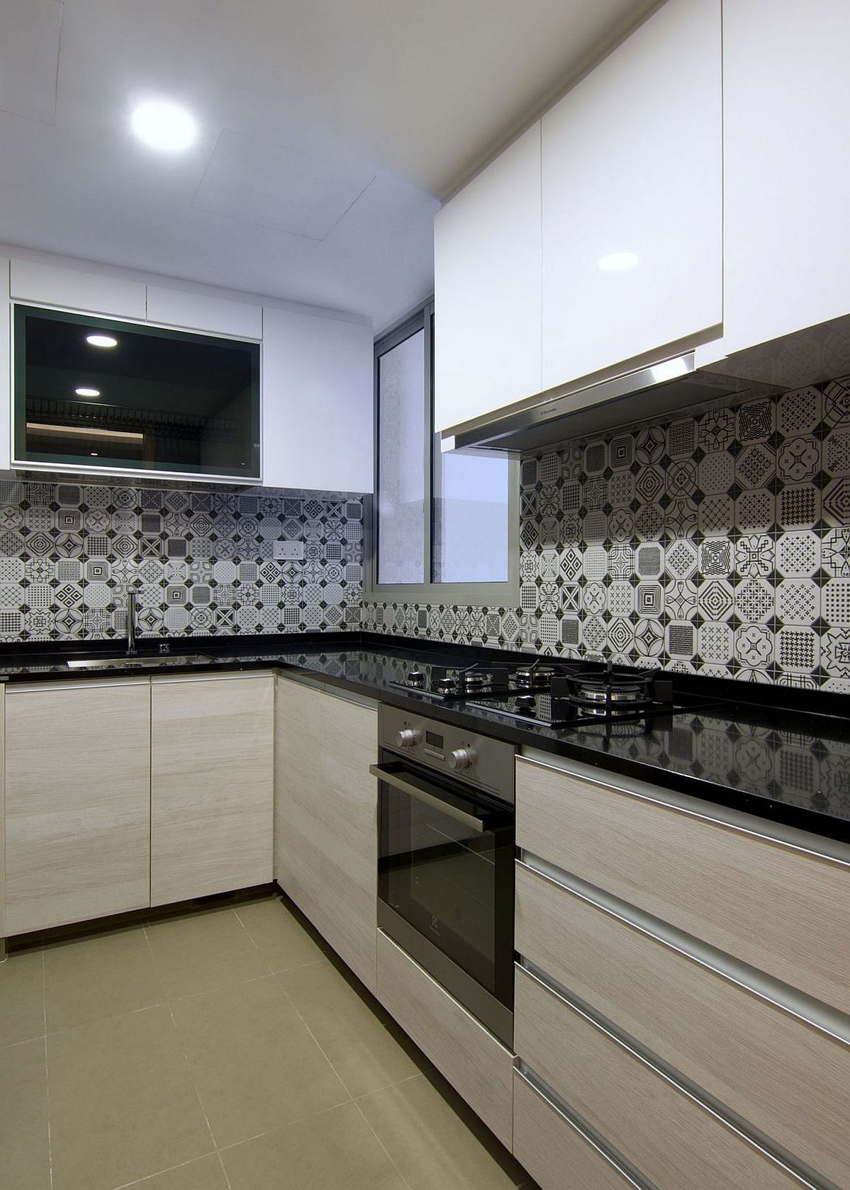 stylish kitchen backsplash with patterned tiles in black