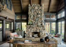 Stylish stone fireplace and live edge table for the spacious sunroom