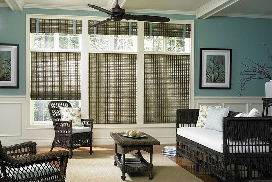 Sunroom in teal with woven shades and rattan decor