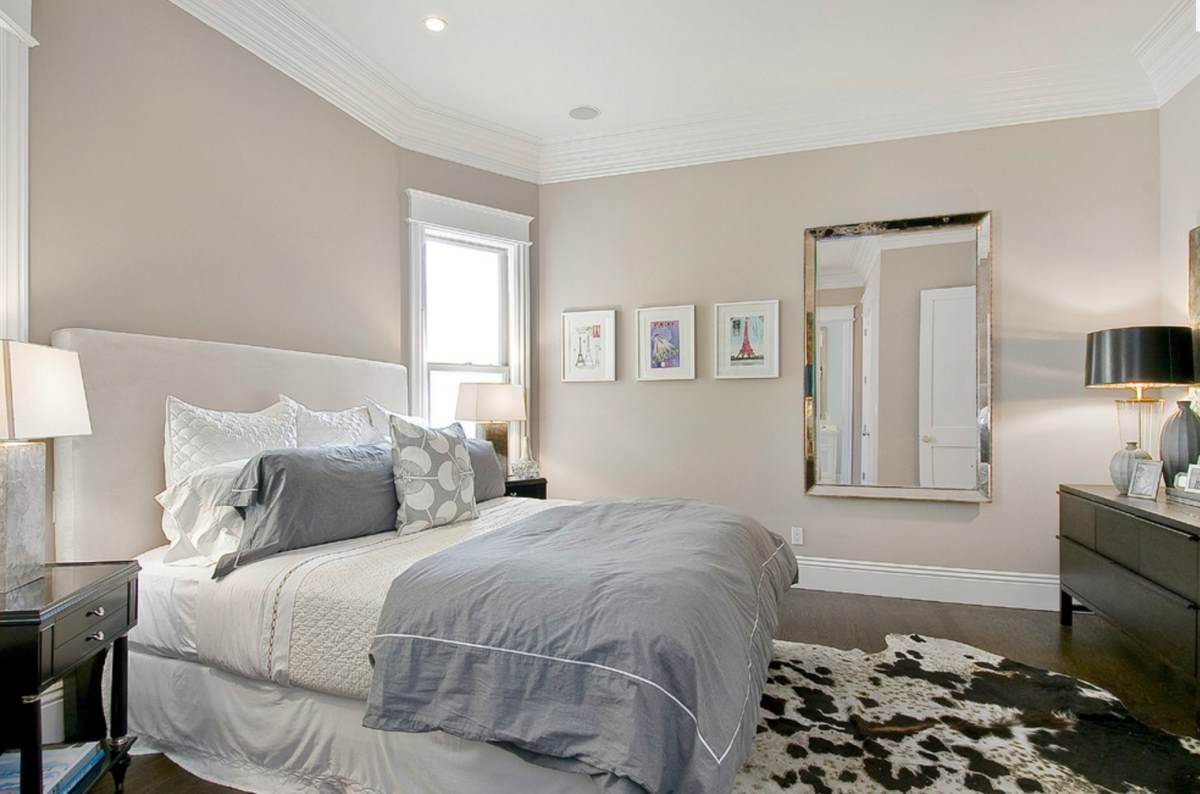 Taupe bedroom with dark wooden floors