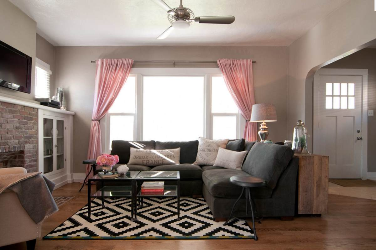 Taupe living room with pink accents