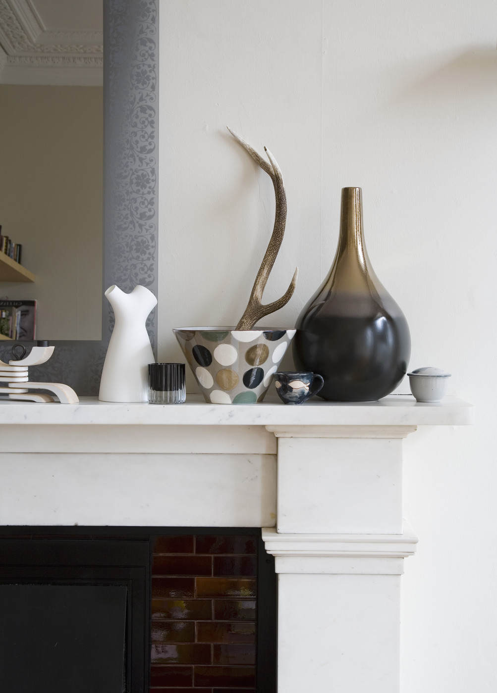 Taupe meets grey on a fireplace mantel