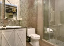 Taupe wallpaper in a modern eclectic bathroom