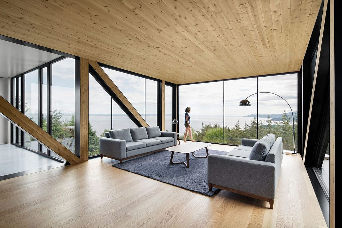 Top level living area with glass walls and a breathtaking view