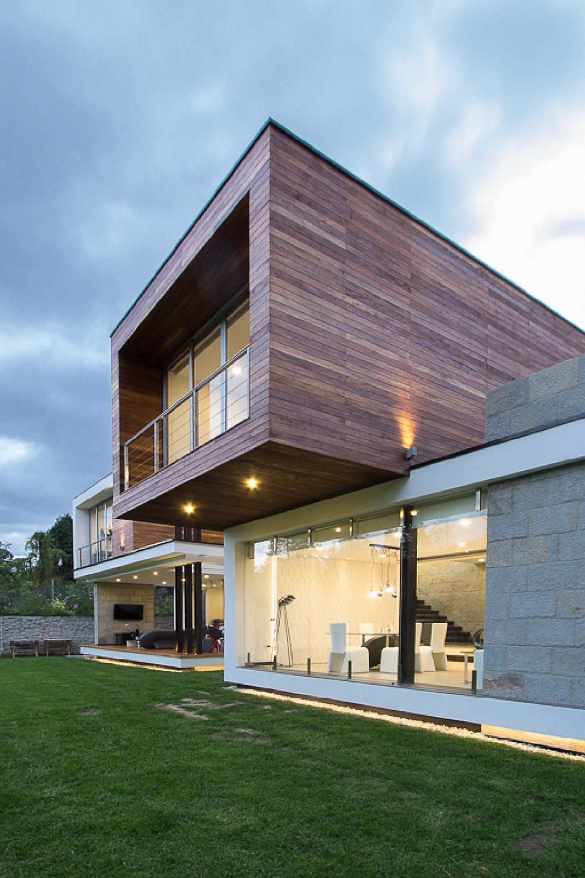 Top level of the house is draped in wood while the bottom structure is made from stone