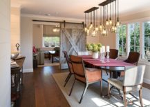 Traditional-barn-door-separates-the-dining-room-from-the-family-room-217x155