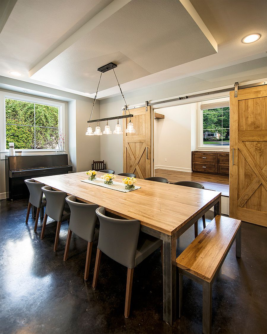 Traditional dining room with sliding barn door [Design: Mezger Homes]