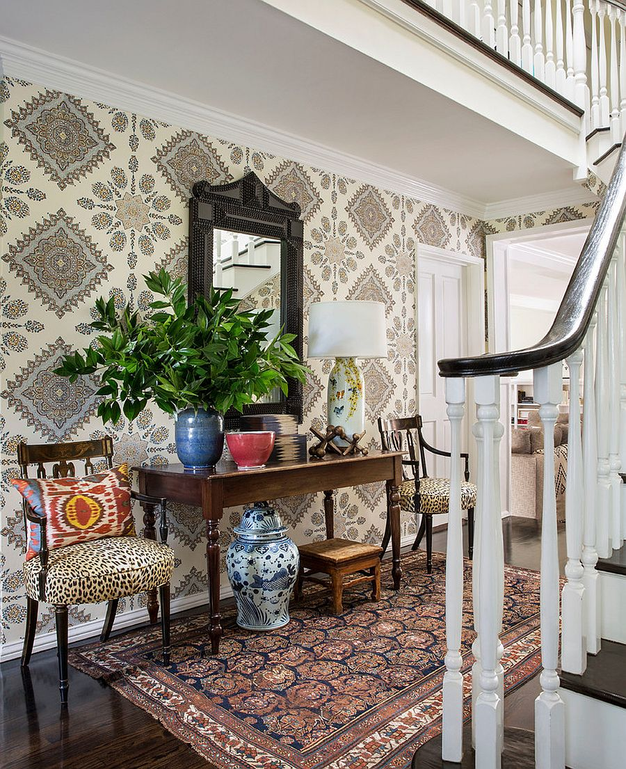 Transitional entry with wallpaper that adds classic pattern to the room [Design: Burnham Design]