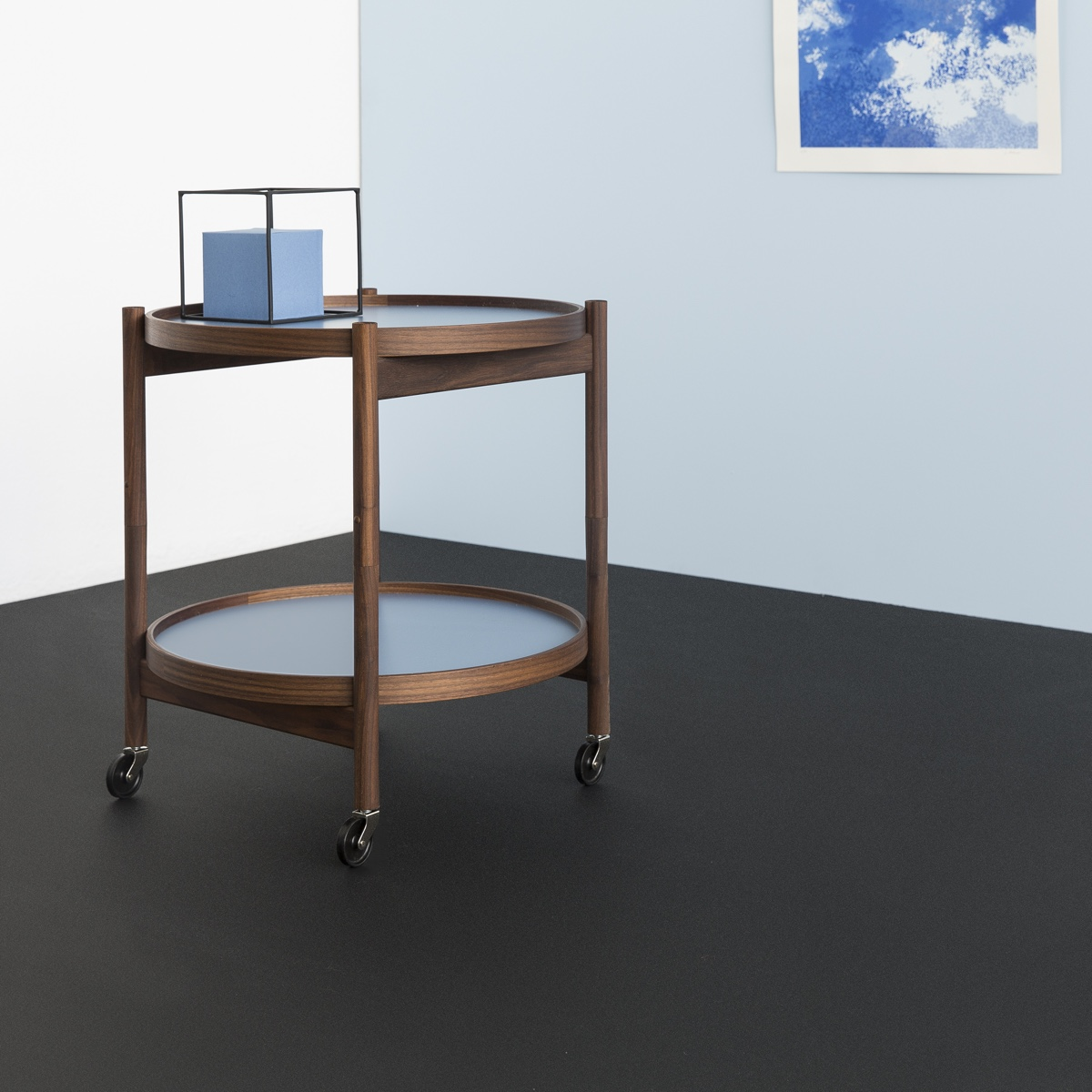Hans Bølling's designed his classic Tray Table in 1963. A midcentury Danish design icon, the Tray Table is both aesthetically pleasing and functional. The Bølling Tray Table is pictured in a Storm Blue colour. Image courtesy of Brdr. Krüger.