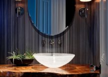 Tropical-powder-room-with-a-refined-backdrop-and-live-edge-vanity-217x155
