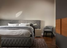 Tufted headboad for the large bed creates an air of luxury in the bedroom