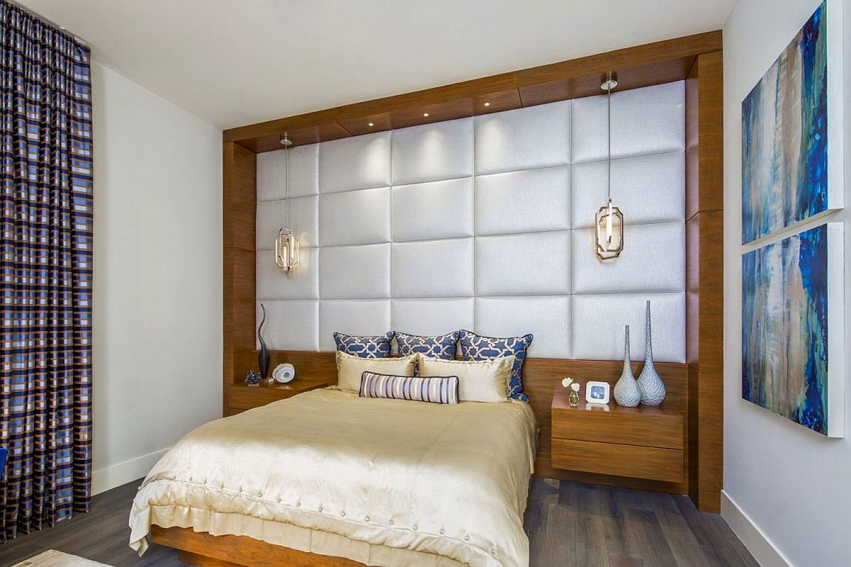 Tufted headboard wall brings opulence to the bedroom
