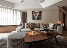 Tufted ottoman and stylish coffee table at the heart of the round living space