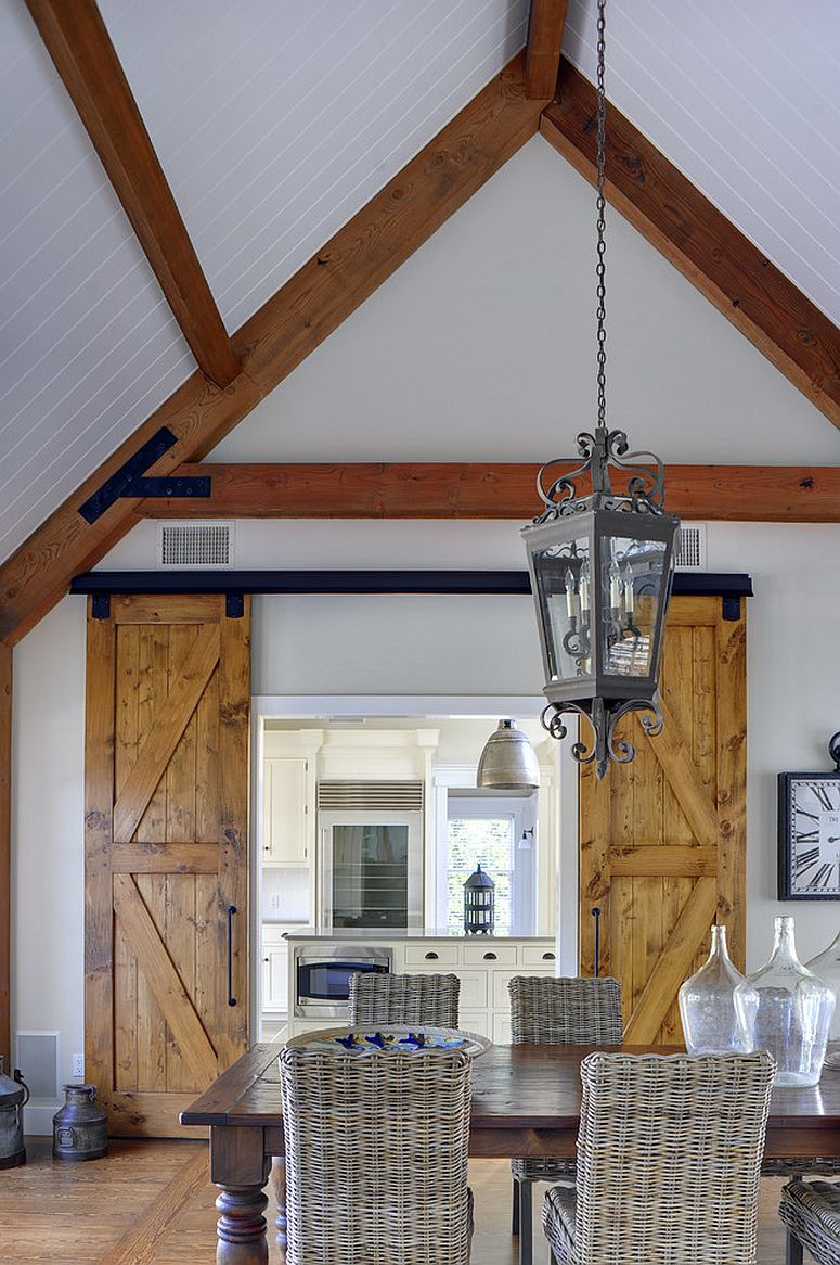 Twin barn doors are perfect for the dining room with gabled ceiling [Design: Yankee Barn Homes]