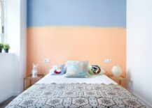Two-toned wall in an eclectic bedroom