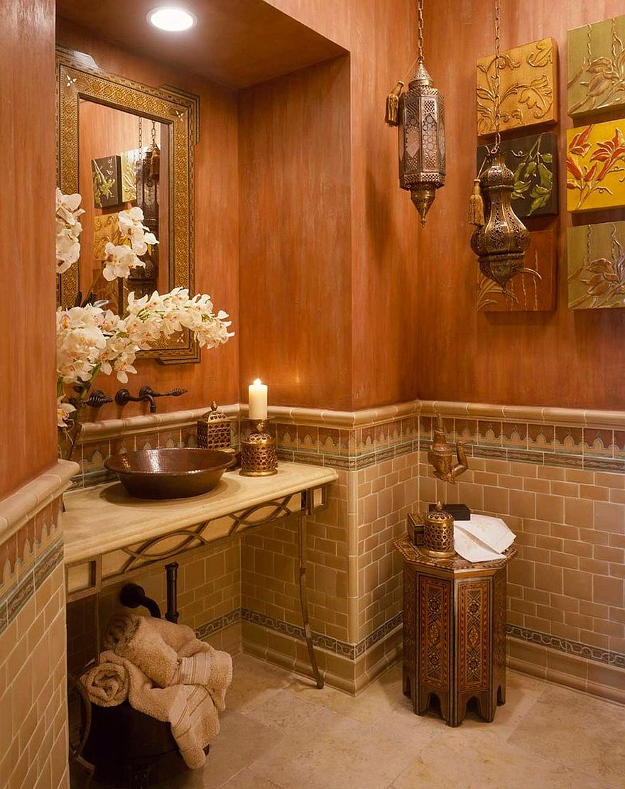 Unique decorative pieces on the wall, Moroccan style lighting and textured walls for the Mediterranean powder room [Design: Martin Architect / Rosana Fleming]