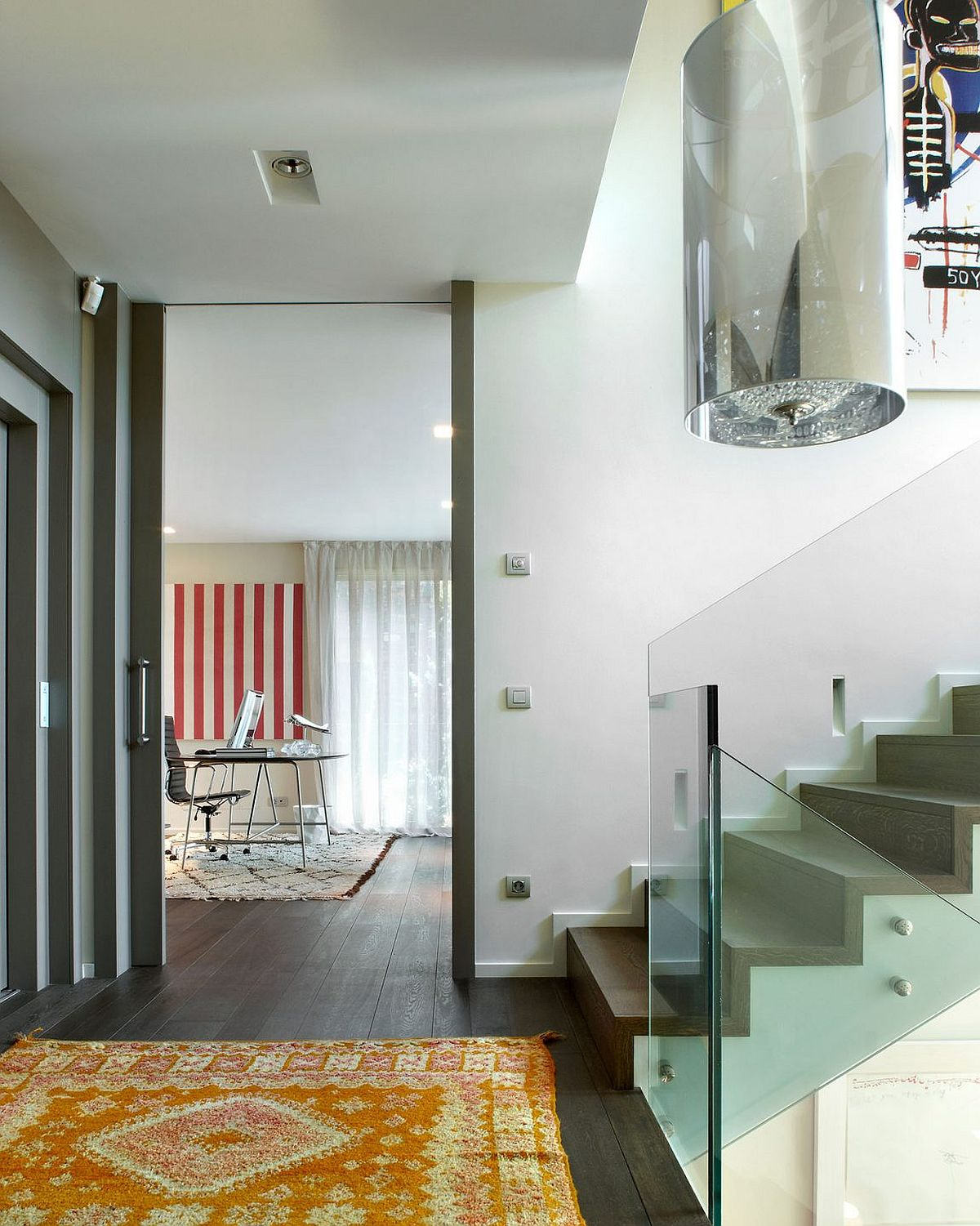 View of the home office and staircase that divides the home into two identical halfs