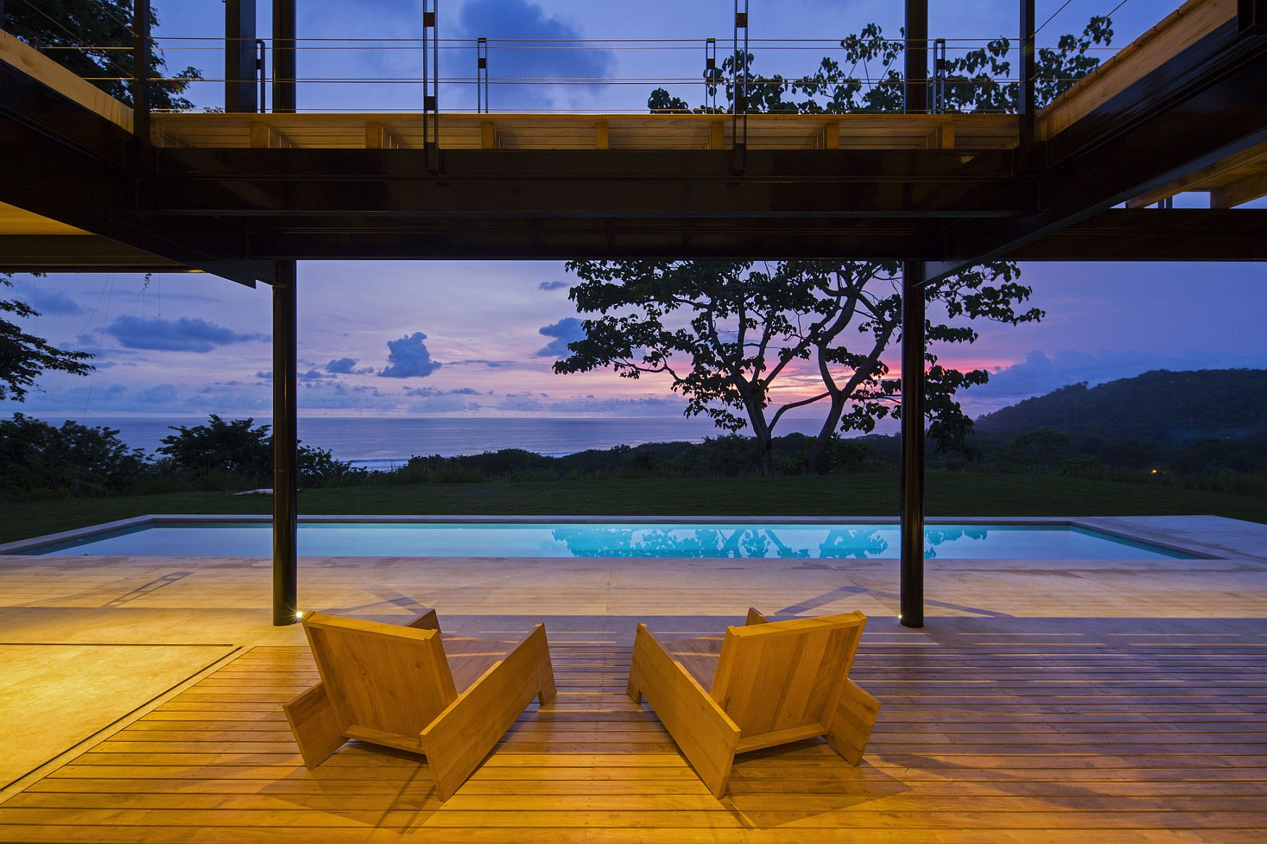 View of the ocean and the green landscape from the spacious contemporary deck