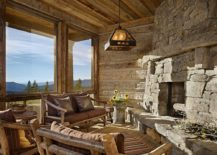 View outside the window and stone walls shape an idyllic rustic sunroom