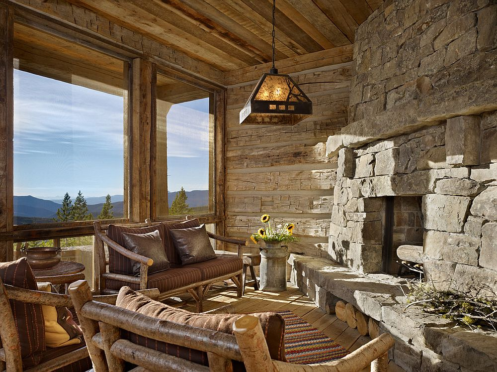 View outside the window and stone walls shape an idyllic rustic sunroom [From: Yellowstone Traditions / Benjamin Benschneider Photography]
