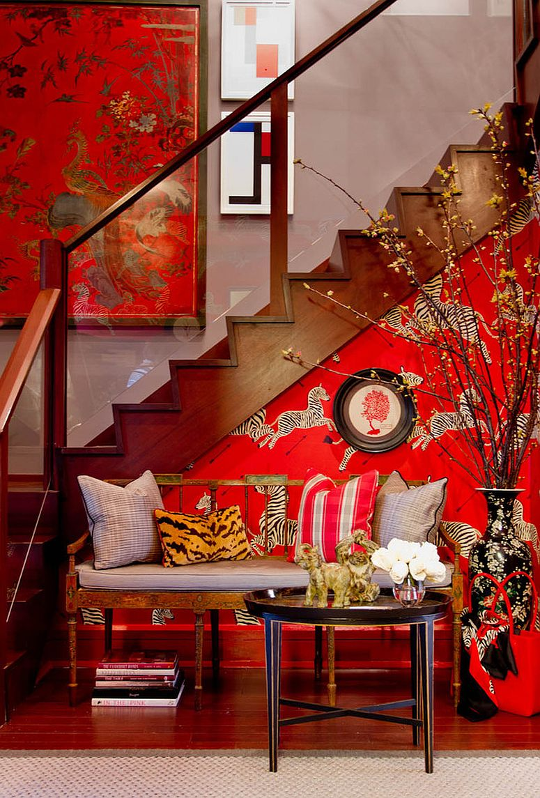 Vivacious zebra wallpaper in Masai Red for the small eclectic entry complements the stairway wall art [From: Bryant Keller Interiors / Rikki Snyder]