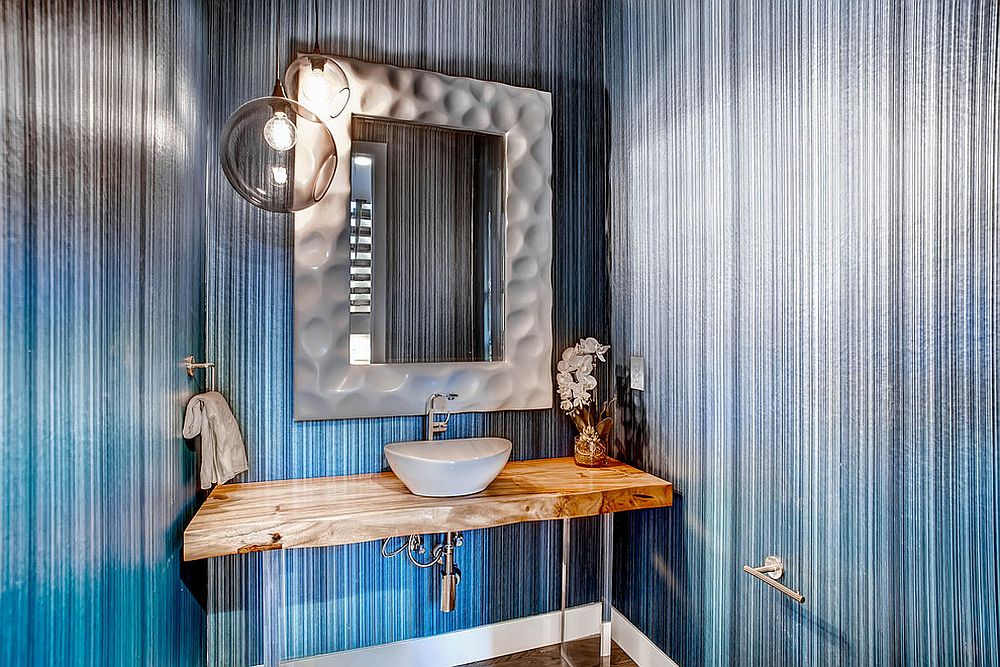 Wallpaper adds brightness to the small powder room with live edge vanity