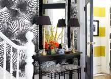 Wallpaper brings glamour to the entry while complementing the console perfectly