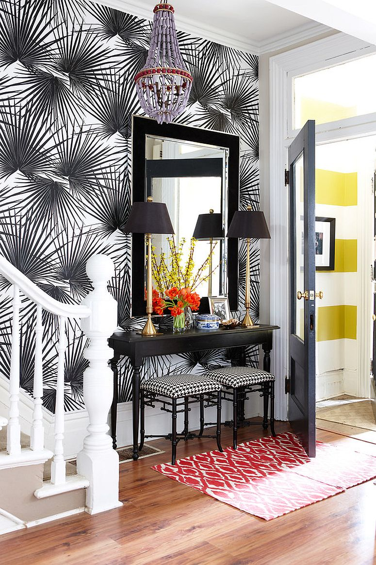 Wallpaper brings glamour to the entry while complementing the console perfectly [Design: Meredith Heron Design]