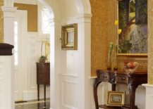 Wallpaper brings warmth of yellow to the Victorian style entry