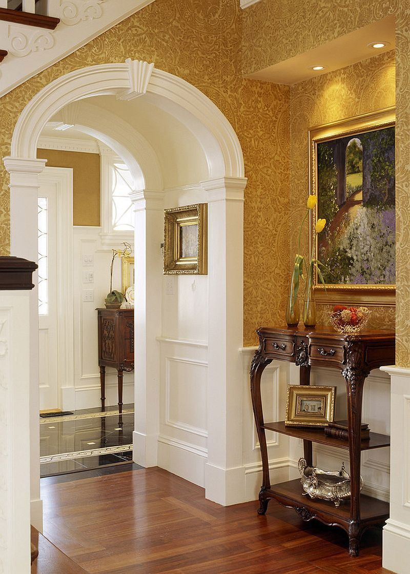 Wallpaper brings warmth of yellow to the Victorian style entry [Design: Siemasko + Verbridge]