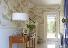 Wallpaper connects the traditional entry with hallway and the living room beyond