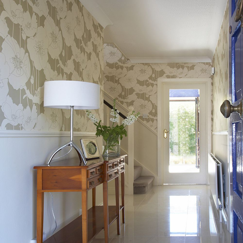 Wallpaper connects the traditional entry with hallway and the living room beyond [Design: Optimise Design]