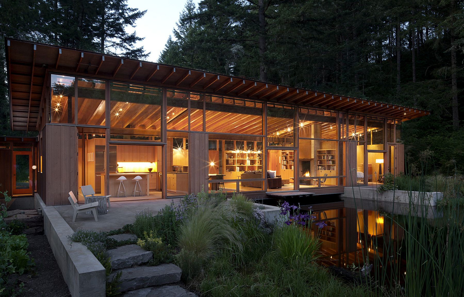 Warm lighting creates an inviting, natural environment at the Newberg Residence