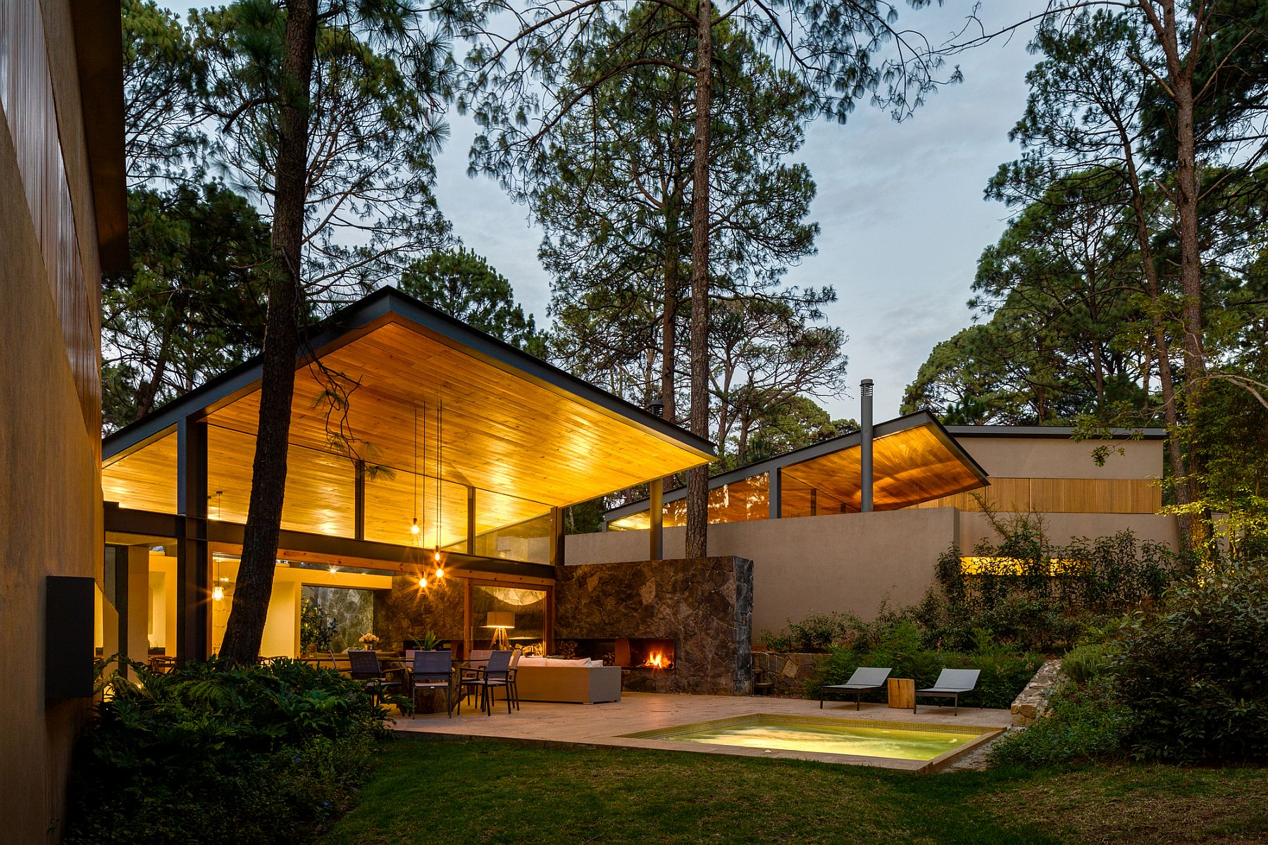 Warm wooden ceiling gives the house an inviting, yet modern appeal