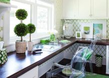 White home office filled with green accents