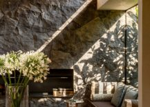 Window seat and natural stone wall inside the tranquil home