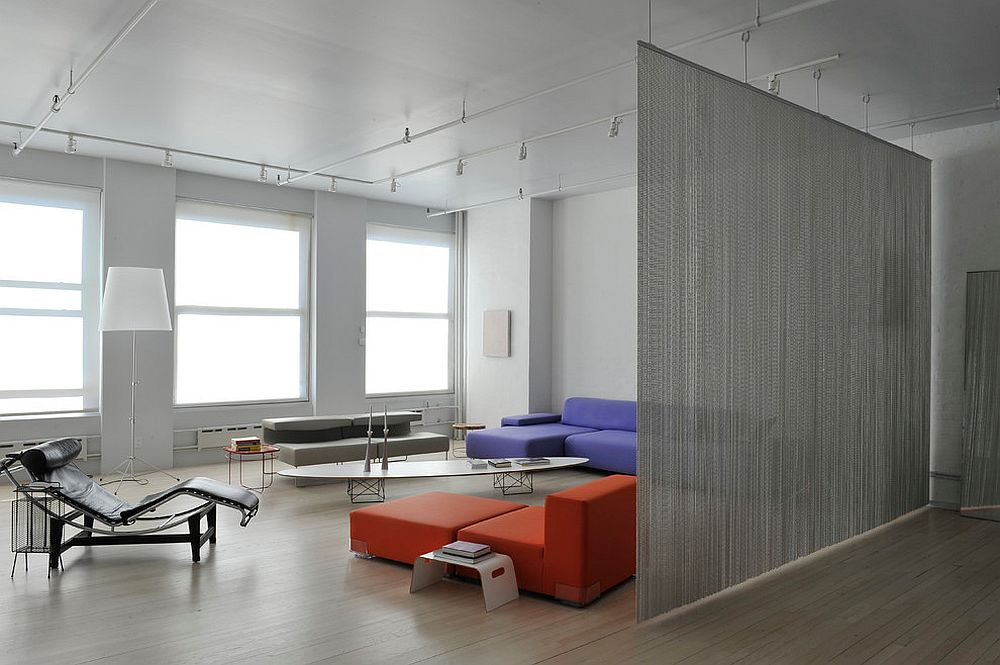 Wire mesh used as room divider in the contemporary living room of New York home [Design: BarlisWedlick Architects]